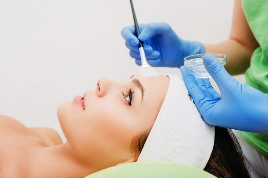Custom Peels and Lifts offered at Skin Solutions - Image of woman laying down and getting a Custom Peels