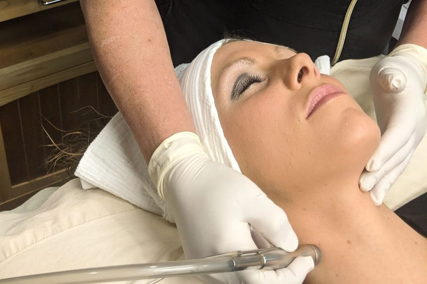 Dermasweep & Microdermabrasion at Skin Solutions with a doctor working on patient's neck.